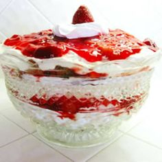 strawberry angle food dessert:       1 (10 inch) angel food cake      2 (8 ounce) packages cream cheese, softened      1 cup white sugar      1 (8 ounce) container frozen whipped topping, thawed      1 quart fresh strawberries, sliced      1 (18 ounce) jar strawberry glaze