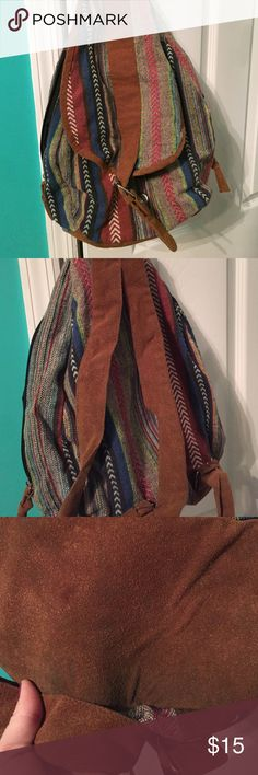 Tribe back pack! Tribe backpack. I've had it in my closet for a while so it's collected some dust. The bottom of the bag is dirty (picture show ) however I think throwing it in the washer would clean it up some! Cute for traveling to throw some things in! Forever 21 Bags Backpacks