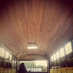 Our skoolie ceiling front the from to the back. Using red oak hardwood flooring from Menards. Using hex screws to install.  #skoolie #skoolieconversion #busconversion #buslife #schoolbus #schoolbusconversion