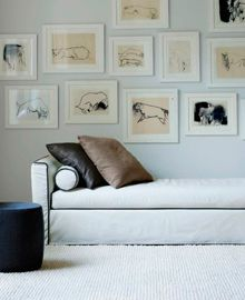 Wall art with a series of drawings.