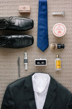 Grooms Details. Love flat lay wedding shots. Get all of the grooms wedding details in the one photo.  #flat #Lay #wedding Details #groom Details #suits and #ties Photos by Hilary Cam Photography