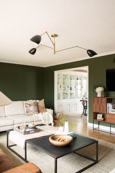 Forest Green Living Room Makeover featuring a special paint formula of Fig Tree by Behr., mid-century modern pieces and brass accents! Living Room Green, Green Rooms, My Living Room, Living Room Interior, Living Room Furniture, Living Room Decor, Modern Furniture, Green Walls, Cottage Living