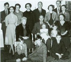 Prince Edward, Duke of Kent; Princess Margaret, Princess Alexandra of Kent, the Duchess of Kent, the Duke of Gloucester, Princess Elizabeth, Princes Philip,Duchess of Gloucester.  Middle row--Queen Mary, King George VI holding Princess Anne, Queen Elizabeth holding Prince Charles; front row--Prince Richard of Gloucester, Prince Michael of Kent, Prince William of Gloucester.