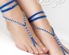 Foot jewelry perfect for the summer. One size fits all. They can be worn barefoot or with shoes. For any barefoot activity like sunbathing, belly dancing, yoga, pilates, hippie wedding, beach wedding...  100% cotton yarn, glass beads. Care: hand wash - lay flat to dry. Ready for shipping!!! Please convo me if you have any special requests for a different color. Designed and hand crafted with Love by VascoDesign