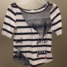 Anthropologie hot air balloon shirt Anthropologie -- size M. RUNS VERY SMALL!!!! Navy blue and white half sleeve top, with hot air balloons and stripes. Has a small pink anchor in the bottom corner! New without tags, didn't fit me! Anthropologie Tops Tees - Long Sleeve