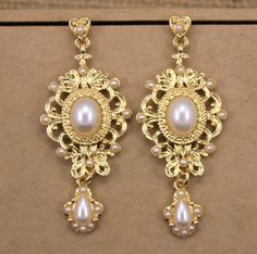 Aliexpress.com : Buy 2015 beand big pearl Pendants earrings catwalk exaggerated Baroque pearl earrings bridal jewelry earrings for women nightclub from Reliable earring wood suppliers on xing long forever  | Alibaba Group