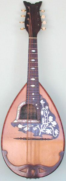 Bowl-back Mandolin by E. De Cristofaro. c.1900 I love the whole look of this, especially the bell shaped, off-center sound hole, the clean, uncluttered back and the engraving on the tuning machine covers. A better set of images is available here (can't pin from this page): http://www.vintage-instruments.com/navigate/catidx7.htm You have to click on the camera icon for the image. it's # 2