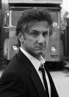 Sean Penn. i don't care what anyone says, he's always been mysteriously good looking in my opinion.