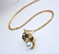 Black onyx and pearl screaming skull by CrossStreetJewelry on Etsy, $39.99