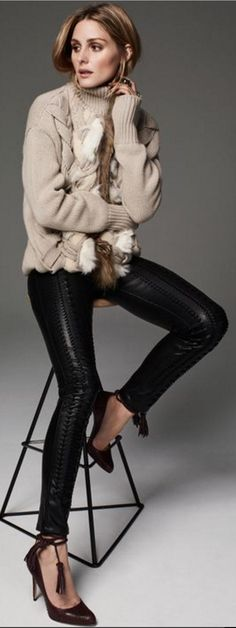Who made  Olivia Palermo's tan turtleneck sweater, black leather lace up pants, and tassel pumps?