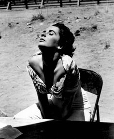 Elizabeth Taylor on the set of Giant, 1955. photo by Sid Avery