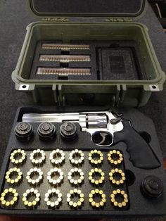 """""""Now this is a case of bad medicine! Underneath the top tray of the revolver case is room for more storage."""" - this optimizes the use of a revolver loader. Press the loader over the ring of bullets, pop them into your revolver cylinder, take your shots and keep your loaders loaded 18 + 3 = 21 full reloads! ~;^/>"""