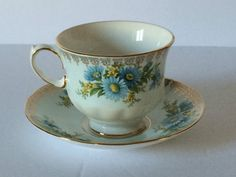 Queen Anne COLLECTIBLE TEA CUP SAUCER Gold Trim Blue Daisies Marygold Pat 8555