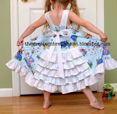 Single layer Feliz dress with ruffled back.