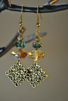 Hey, I found this really awesome Etsy listing at http://www.etsy.com/listing/111364406/amber-bicone-and-teal-czech-glass