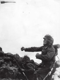Whenever the Germans lost a position, they were quick to mount counterattacks with their tactical reserves. Here, a soldier hurls a stick grenade at the enemy. The Germans proved masterful at scraping...