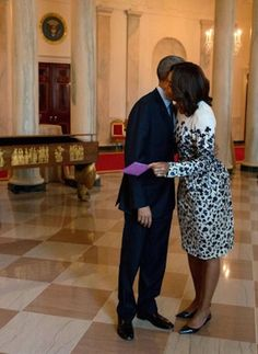 12feb2015---president obama gives first lady michelle obama an early valentine's card before departing on a trip to california.
