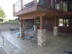 New Deck, stamped patio, stone columns and retaining walls