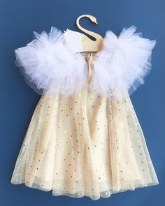 Baby tulle cape; princess cape; baby party accessory; fall accessory; baby winter; baby gift guide  Our beautiful white Tulle cape is the most perfect and cutest accessory to lux up your little one's holiday outfit. Only a few available as it is a labor of love, and only available for a limited time. Be sure to snatch one soon!