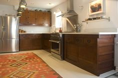 kim kitchen 4 - asian - kitchen - other metro - Adi Tatarko  Love it!  The cabinetry is gorgeous and the rug is fabulous.