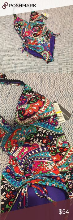 Kenneth Cole Reaction swimsuit NWT size M Beautiful one piece swimsuit from Kenneth Cole Reaction in paisley print. Halter neck. Also ties at mid back. Lightly padded with no underwire.  Rouching with tie at leg.  NWT and in perfect condition. Kenneth Cole Reaction Swim One Pieces