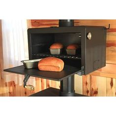 Oven attaches to exhaust pipe of wood burning stove... so want one of these!