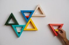 holly-go-brightly:  DIY Triangle Shelves - A Beautiful Mess I love the way these shelves look, possibilities are endless with colour combinations, too.