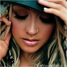 christina aguilera - love everything about this . . . nose ring, eye makeup, nails, lips, hair, hat <3