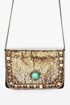 Kimchi Blue Art Deco Jeweled Clutch $49.00 @ urbanoutfitters.com I never go anywhere fancy, but if I had the chance, I would love to carry a purse like this one. It has bling, but the turquoise-y jade-looking stone brings it back down to Earth.