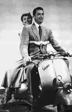 "Audrey Hepburn and Gregory Peck on a Vespa scooter in ""Roman Holiday"""