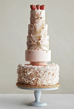 Brides: Glamorous Five-Tiered Blush Wedding Cake. Nothing says romance like strawberries and champagne. Cake artist Nadia Colella of Nadia & Co. interpreted this delicious pairing into a cake design featuring a ruffled bottom tier, handmade sugar sequins forming a butterfly pattern, bubble sugar, tiny rose petals, and a topper made of handcrafted sugar strawberries.