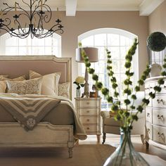 I like what these sprigs add (and in the wide-bottomed bottle) to this French Provencial Bedroom