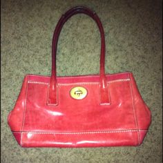 Authentic Coach Leather purse- CLEARANCE!!! Authentic Coach coral leather purse- used so it has imperfections on the outside leather- specifically on the back side - seen in picture- please look closely at pics before buying since it does have imperfections - it is still a nice purse so I will list it low due to condition, but I will not accept low ball offers because it is still a beautiful authentic Coach purse Coach Bags
