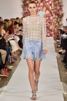 It is not knitted, but it is possible to crochet a similar one ;) Spring 2015 LOOK 13 Ivory clover guipure top $1290