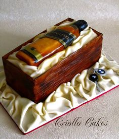 Whiskey Bottle Cake    Lemon buttercake filled with lemon curd and iced with white chocolate buttercream.