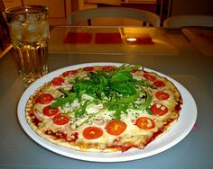 Make your own pizza dough.  This looks fairly easy and pretty good.  It beats those conveyor belt frozen pizzas