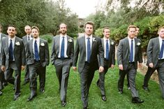 Something blue for the boys too. Charcoal grey and navy blue wedding attire. Would love a pop of mustard yellow with this in the boutonniere.