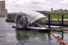 """The city of Baltimore has installed a solar-powered water wheel that can process 23 metric tonnes of floating garbage every day.: This is the first """"truly feasible"""" contraption to reduce ocean plastic."""