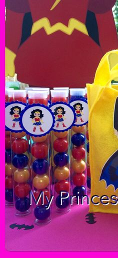 PLEASE READ BEFORE PURCHASING!!!! GUM BALLS ARE NOT INCLUDED!!!!!  Listing is for 10 Wonder Woman clear Gumball tubes. Perfect party favors for your little guests. Each tube measures approximately 1x 8and fits 8 gum balls. Listing is for tubes with tags only. Our tags are printed on high quality photo paper for a glossy finishing look. We do NOT print on cardstock! **Gum balls NOT included**  Turn around is 3-4 weeks. MPTB