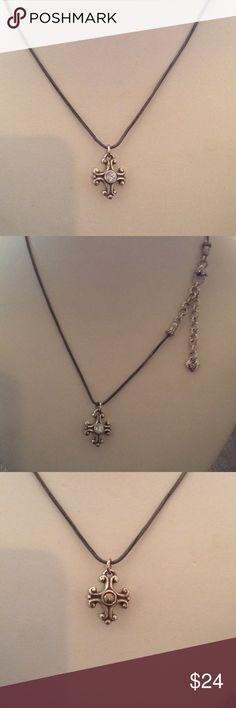 """Brighton Cross Necklace Brighton Cross with reversible. Cz on one side solid on the other. The chain is 16"""" with a 2"""" extension. The chain is a bit darker than the piece .  Maybe over time that happened. Brighton Jewelry Necklaces"""