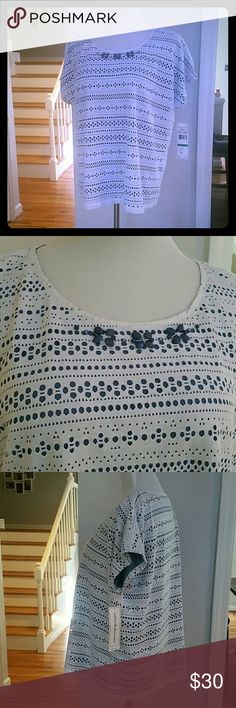 NWT ALFRED DUNNER SHORT-SLEEVE TOP NWT Alfred Dunner Short-Sleeve Top  Size : Large  Materials :  Outer: 100% POLYESTER  Inner : 93% POLYESTER  7% SPANDEX Alfred Dunner Tops Tees - Short Sleeve