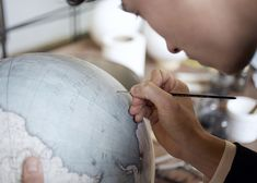 A failed attempt at finding a well crafted globe, a gift for his father, was the inspiration behind Peter Bellerby's year and a half long journey to master the art of making artisanal globes – a craft that is so extremely difficult, it's no wonder there is only one other person in the world that shares in this complex skill. Each component of the globe is constructed by hand – from casting the spheres to hand painting the illustrations.