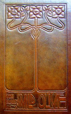 Embossed leather book cover...The Crown of Wild Olive by John Ruskin...I collect editions of this book...don't have this one!