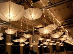 Umbrella decoration ideas So many ways to use umbrellas. Call your friends over or celebrate the rains simply because you love them with these pretty umbrella decoration ideas White Umbrella, Umbrella Lights, Diy Wedding Reception, Wedding Events, Weddings, Umbrella Decorations, Wedding Decorations, Umbrella Wedding, Wedding Umbrellas