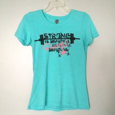 "NWOT Strong is Beautiful Tee NEW WITHOUT TAGS // Aqua ""Strong is Beautiful"" tee. Graphic of barbells and hearts. The pink letters are accented with pink glitter. // Next Level Apparel brand // Sz M. Perfect for the weightlifting/strength training/workout/gym rat / Crossfit ladies out there! Next Level Apparel Tops Tees - Short Sleeve"
