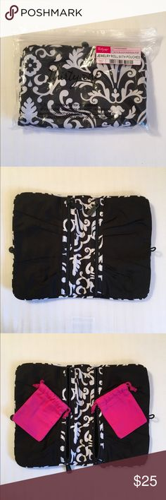 thirty-one Jewelry Roll in Parisian Pop Gently used jewelry roll from thirty-one in Parisian Pop. Comes with two pink pouches (as pictured). Still looks brand new. No holes, rips, or stains. Perfect jewelry holder for traveling women! :) thirty-one Bags Mini Bags
