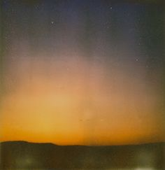 Sunset Sky    Polaroid SX-70 OneStep Sonar with Impossible Project PX70 test film