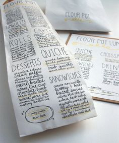 Menu printed on to-go bags.  Smart but prob too exxy