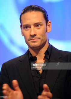 Urs Buhler from Il Divo onstage with their Classical award during the Nordoff Robbins O2 Silver Clef awards at the Grosvenor House Hotel on July 3, 2015 in London, England.