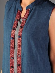 A variety of covered buttons on an ikat placket on this indigo sleeveless jacket